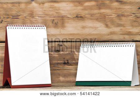 blank desk calendars on wooden table