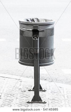 metal wheelie bin on the sidewalk