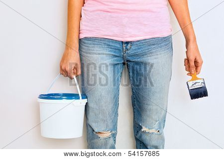 Woman Standing With Paint And Brush Ready To Work