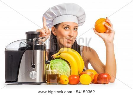 woman cook is pressing the juice from the fruit