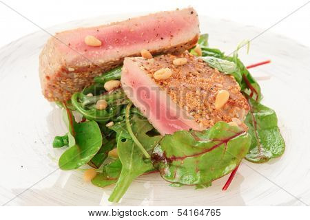 Lightly seared tuna steak and fresh salad