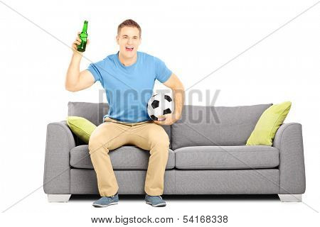 Happy cheerful male sport fan with football and beer watching sport isolated on white background
