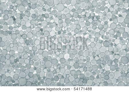 grey foam plastic closeup. Polystyrene foam texture
