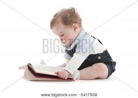 Two Years Old Cute Boy Reading A Book