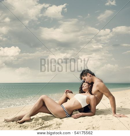 Attractive young couple relaxing on the beach