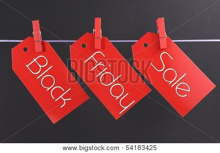 Black Friday Shopping Sale Concept With Message Written Across Red Ticket Sale Tags Hanging From Peg