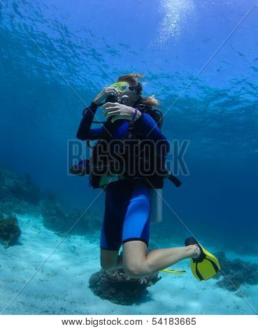 Scuba diver trying to equalize presure on the depth