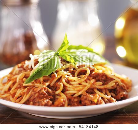 plate full of spaghetti and meat sauce