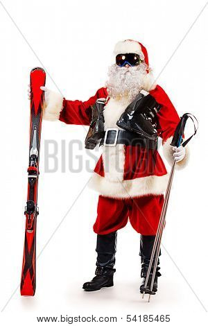 Santa Claus is standing in the ski mask and holding a skiing. Christmas. Isolated over white.