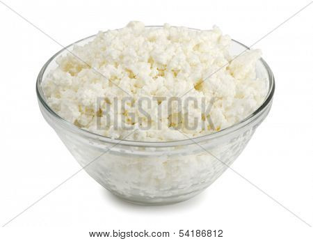 Glass bowl of fresh cottage cheese isolated on white