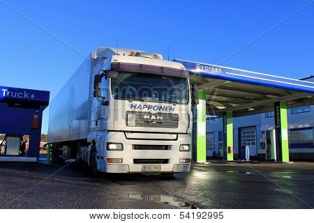 White Man 18.480 Truck And Trailer At A Filling Station