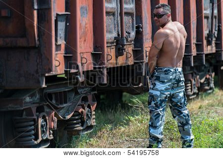 Muscular Man Pissing On Railroad