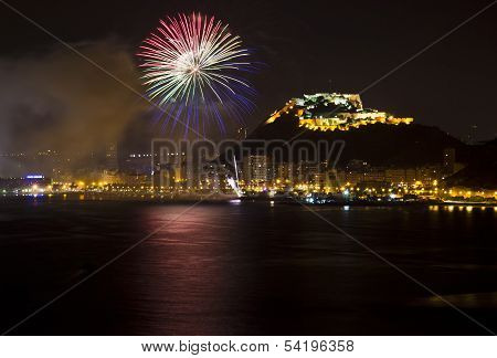 Alicante City by Night with Blue and Red Fireworks