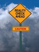 stock photo of realism  - conceptual sign with words reality check ahead caution warning over dark blue sky - JPG