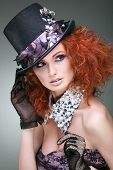 Fashion girl portrait.Accessorys.On grey  background. Red hair.