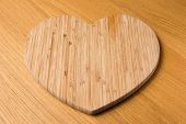 stock photo of septic  - Wooden Heart Shaped Chopping Board on a wooden table - JPG