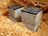 stock photo of sewage  - New septic tank inspection hatches being installed - JPG