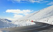 stock photo of snowy-road  - Road Through Snowy Mountains - JPG