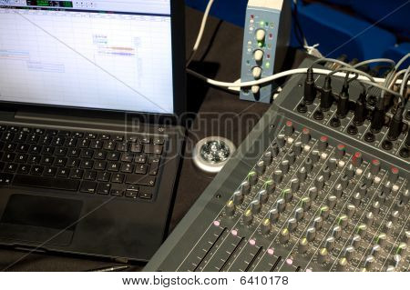 Laptop Computer Next To Sound Mixing Board