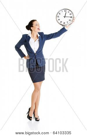 Happy young business woman holding office clock, isolated on white background