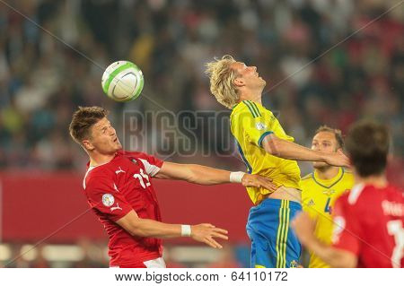 VIENNA,  AUSTRIA - JUNE  7 Ola Toivonen (#20 Sweden) and Sebastian Proedl (#15 Austria) fight for the ball during the world cup qualifier game on June 7, 2013 in Vienna, Austria.