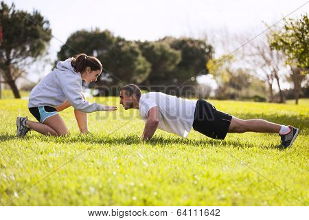 Couple exercising at the city park