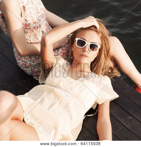 Two Beautiful Girls At Sea Pier