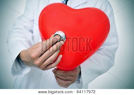 a doctor auscultating a red heart with a stethoscope