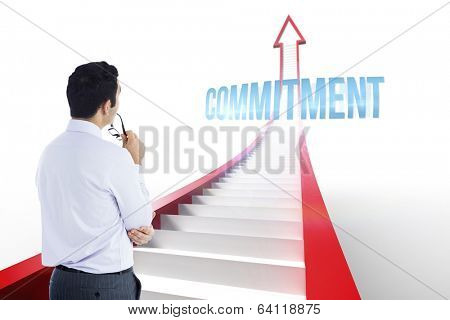The word commitment and businessman holding glasses against red arrow with steps graphic