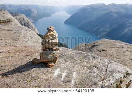 Stack of rocks with mountain and fjord view
