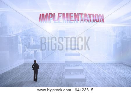 The word implementation and businesswoman with hands on hips against city scene in a room