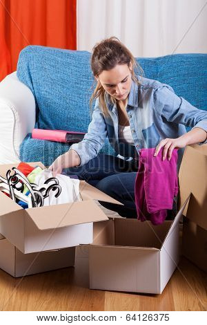 Woman Packing Stuff
