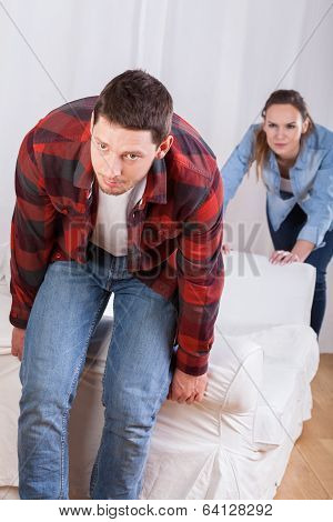 Couple Moving The Couch