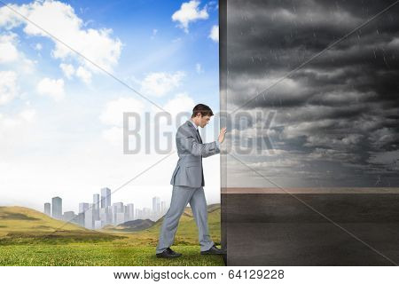 Composite image of businessman pushing away scene of balcony and stormy sky