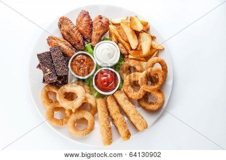 Grilled Cheese, Croutons And Sauces On A Round Plate On White Background