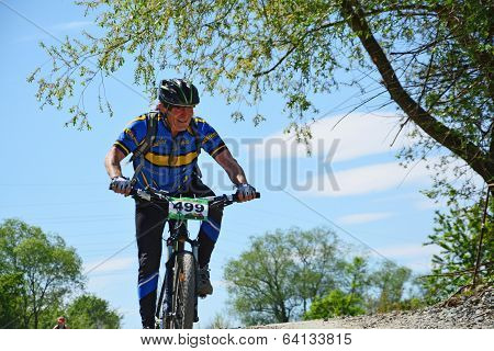 Middle-aged Cyclist On A Mountain Bike