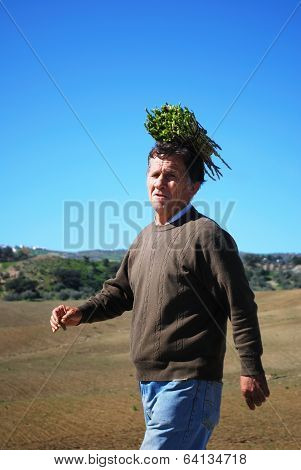 Man with aspargus bundle, Spain.
