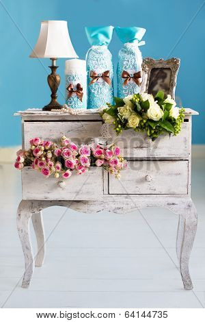 Wedding Accessories For The Morning, The Bride In Pink . Vintage Commode With Flowers. Candles, Cham