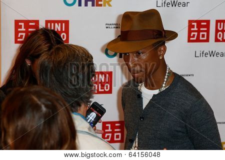 NEW YORK-APR 28: Singer Pharrell Williams attends the Pharrell Williams UNIQLO 'I Am Other' Collection Launch at UNIQLO New York 5th Avenue Global Flagship Store on April 28, 2014 in New York City.