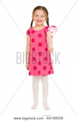 girl in a red dress with flower. studio shot