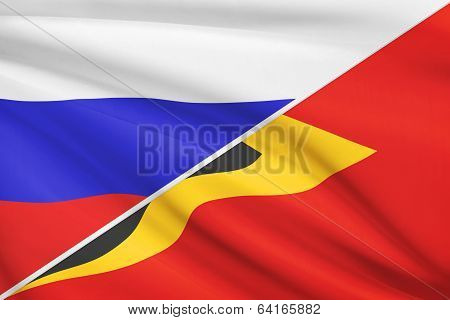 Series Of Ruffled Flags. Russia And Democratic Republic Of Timor-leste.