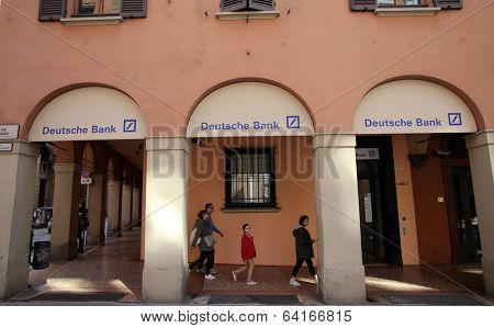 BOLOGNA, ITALY - APRIL 19, 2014: A group of pedestrians walk past a branch office of Deutsche Bank in Bologna, Italy, on Saturday, April 19, 2014.