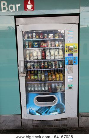 BOLOGNA, ITALY - APRIL 19, 2014: An outdoor vending machine offering snacks and beverages in Bologna, Italy, on Saturday, April 19, 2014.