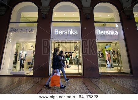 BOLOGNA, ITALY - APRIL 19, 2014: Shoppers walk past a Bershka clothing store in Bologna, Italy, on Saturday, April 19, 2014. Bershka is a retailer and part of the Spanish Inditex group.