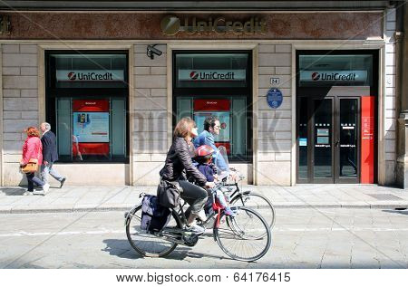 BOLOGNA, ITALY - APRIL 19, 2014: Pedestrians go past a  Unicredit Banca di Roma S.p.A bank office in Bologna, Italy, on Saturday, April 19, 2014.