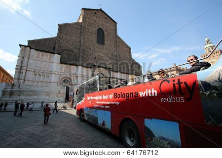 BOLOGNA, ITALY - APRIL 19, 2014: Tourists enjoy a tourthrough the city in a guided bus tour in Bologna, Italy, on Saturday, April 19, 2014.