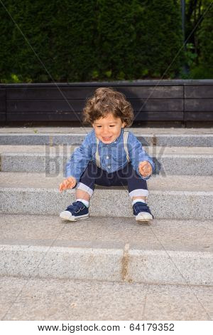 Happy Toddler Boy On Stairs