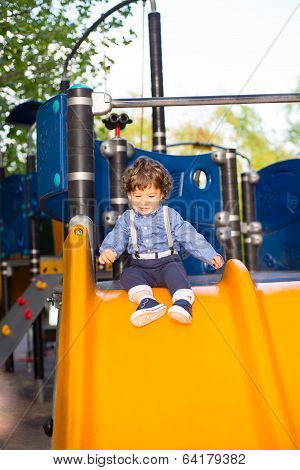 Toddler Boy On Slide