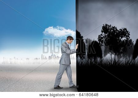 Composite image of businessman changing scenes from dark gothic scene with trees