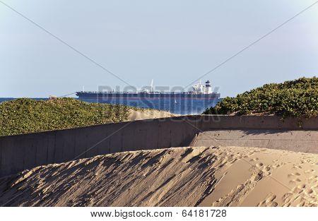 Large Ship Anchored At Sea Behind Estuary